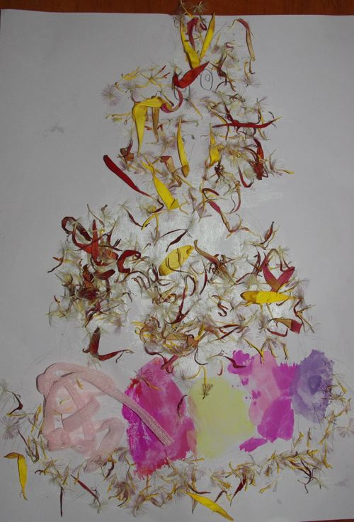 A collage made with flower petals for feathers and the nest