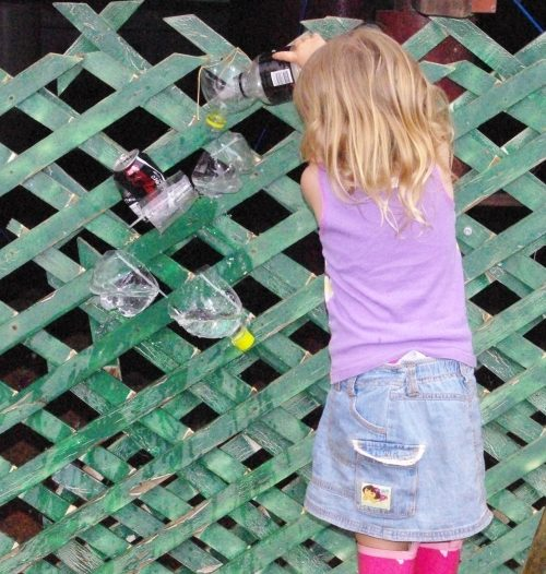 Little girl pouring